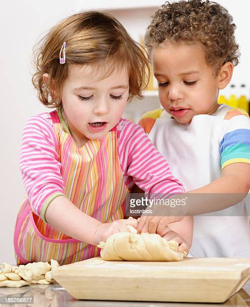 Cute Little Girl And Boy Kneading Dough