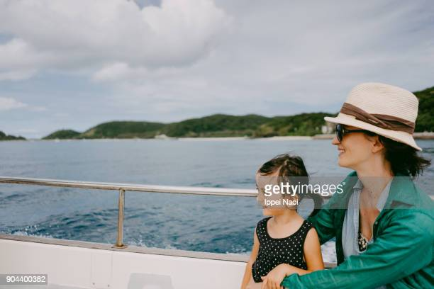 Cute little girl and mother enjoying boat ride