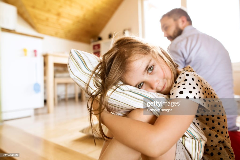 Cute little girl at home with her hispter father : Stock Photo