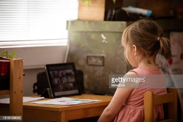 cute little girl attending an online preschool class - mmeemil stock pictures, royalty-free photos & images