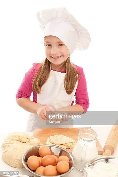 Cute little girl baking - preparing various pastry products