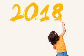 http://www.istockphoto.com/photo/cute-little-girl-drawing-new-year-2018-gm872539500-243714666