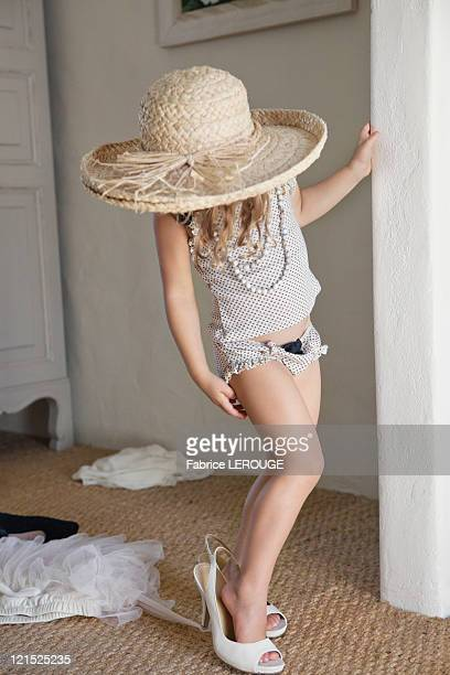 cute little girl dressed like her mother in oversized accessories - oversized necklace stock pictures, royalty-free photos & images