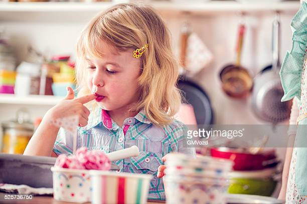 Cute Little Girl Eating Strawberry Ice Cream