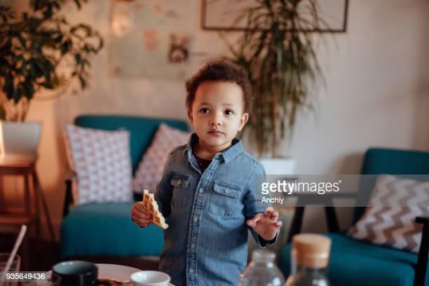 Cute little girl eating waffles