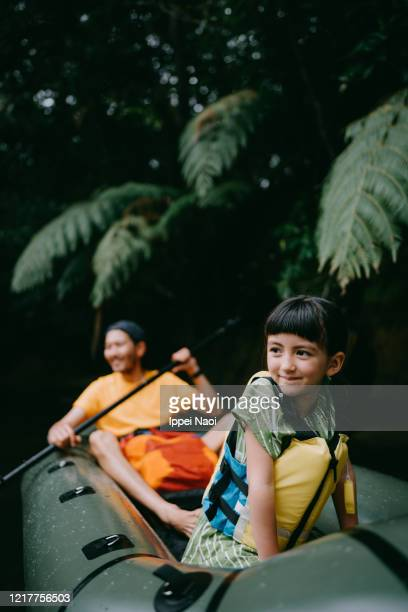 cute little girl enjoying boat ride with father in jungle river, iriomote, japan - reality fernsehen stock pictures, royalty-free photos & images