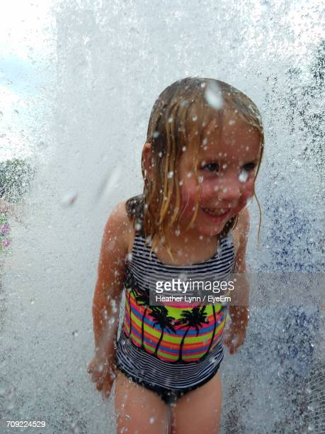 cute little girl enjoying fountain during summer - lynn pleasant stock pictures, royalty-free photos & images