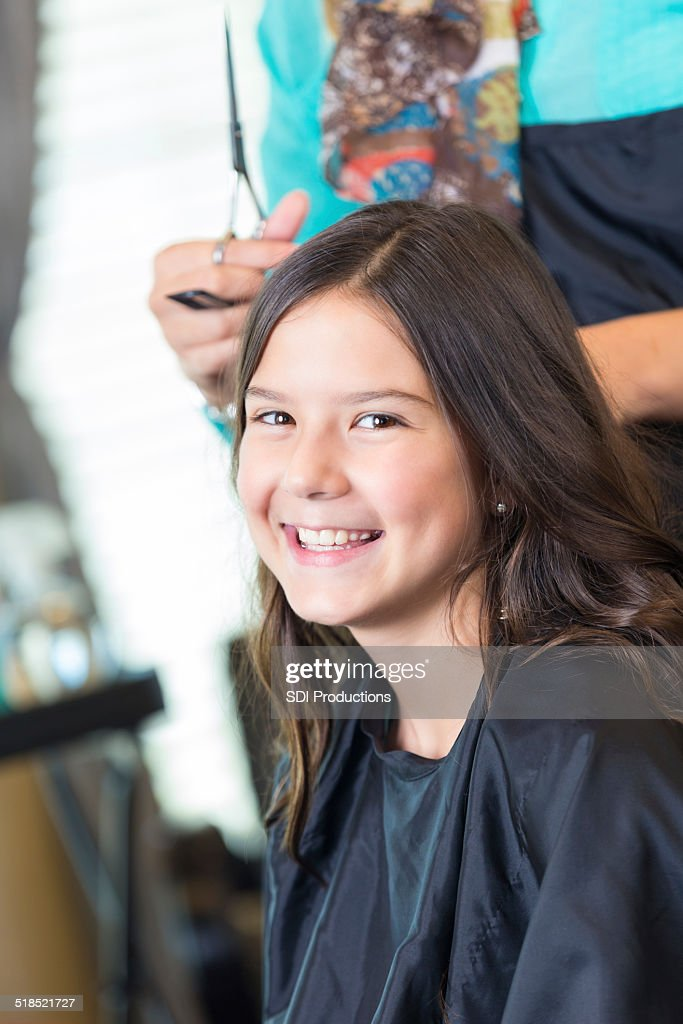 Cute Little Girl Getting Hair Cut By Professional Salon Stylist