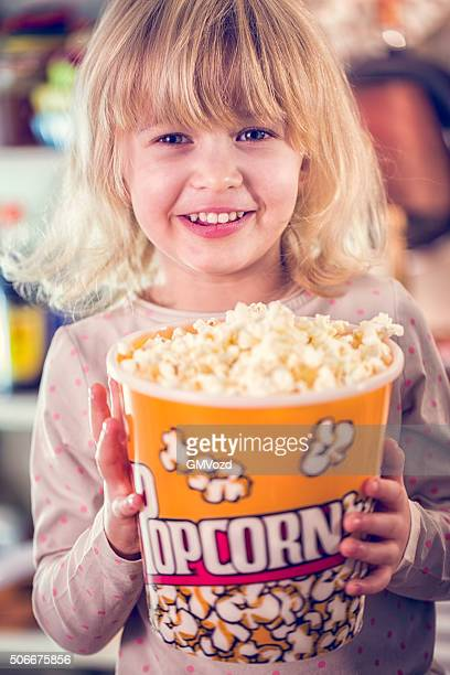 Cute Little Girl Holding a Large Box of Popcorn