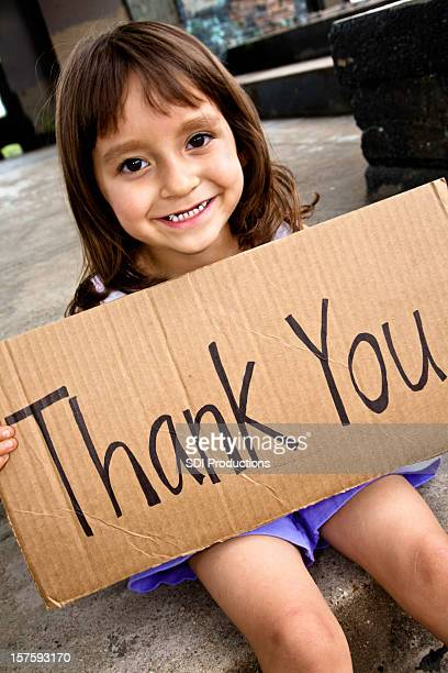 Cute Little Girl Holding a Thank You Sign