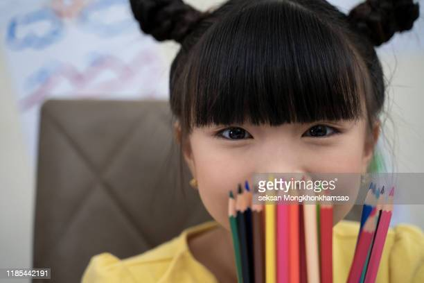 cute little girl holding colorful felt pens - drawing activity stock pictures, royalty-free photos & images