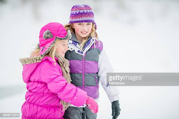 Cute Little Girl Ice Skating Together