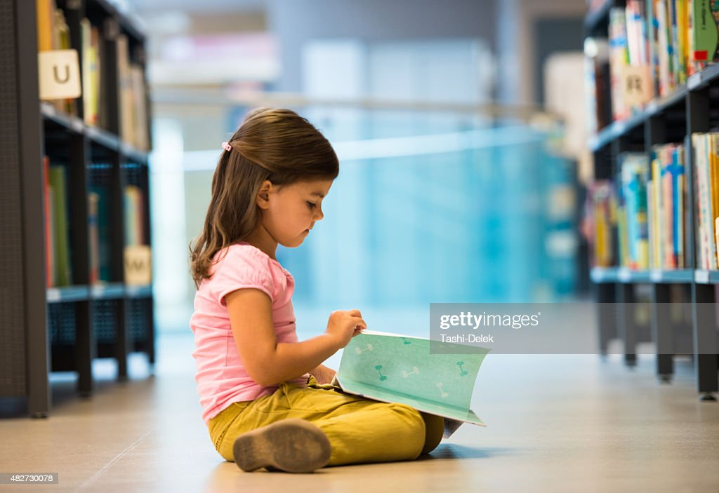Cute Little Girl In Library : Stock Photo