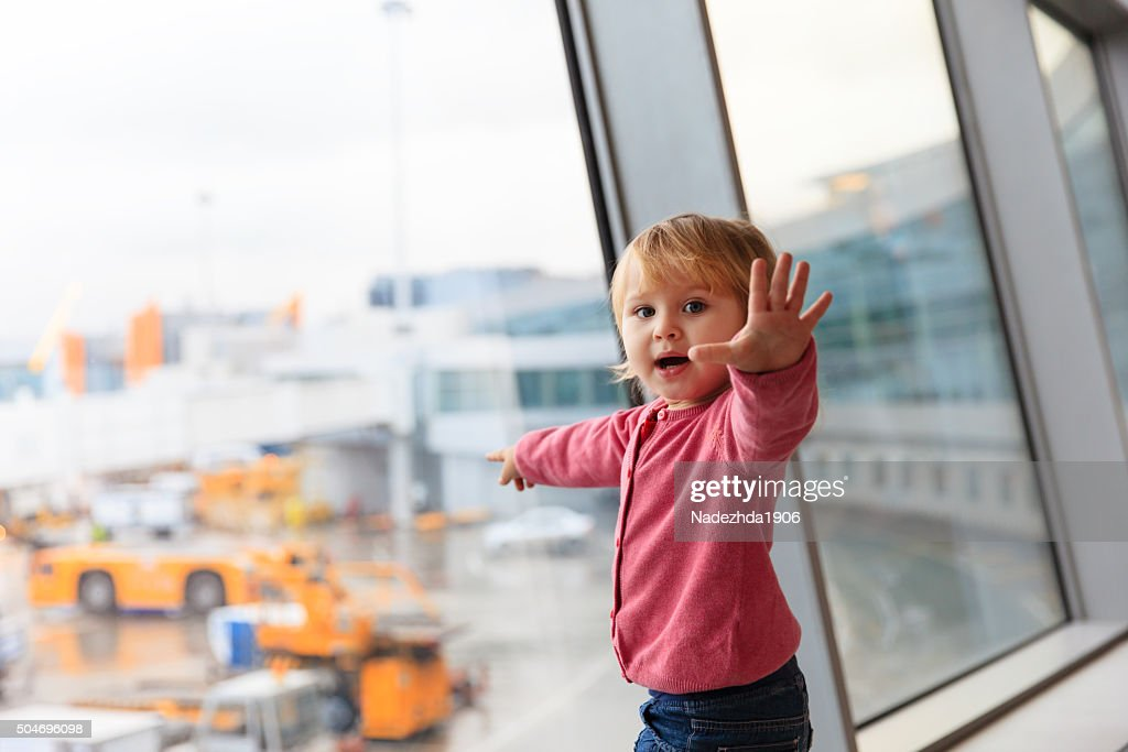 cute little girl in the airport, kids travel : Stock Photo