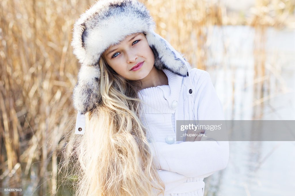 3f1b0f3b20ad Cute Little Girl In Winter Clothes Outdoors Stock Photo