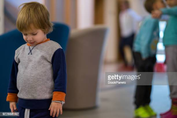 cute little girl is sad because the other kids gossip him - depresion stock pictures, royalty-free photos & images