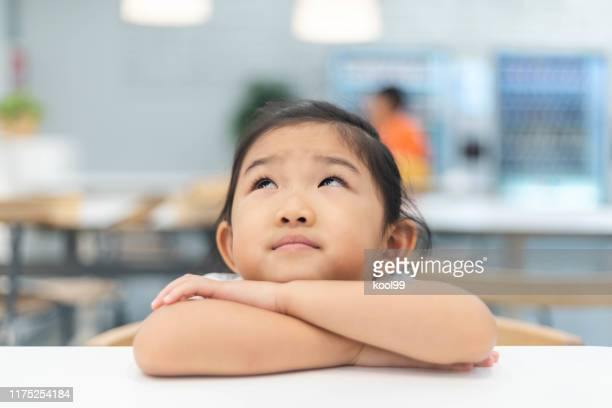 cute little girl is thinking - impatient stock pictures, royalty-free photos & images