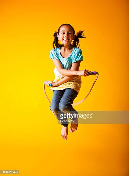 cute little girl jump roping - skipping rope stock pictures, royalty-free photos & images