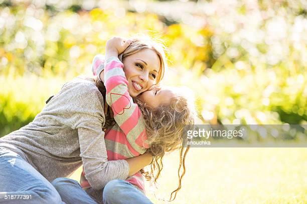 Cute little girl kissing her mom