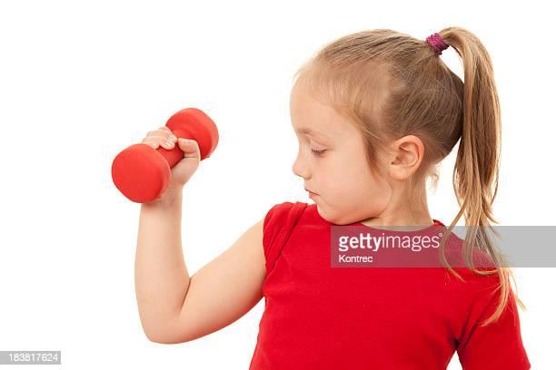 かわいい小さな女の子ウェイトリフティング - kids weightlifting ストックフォトと画像