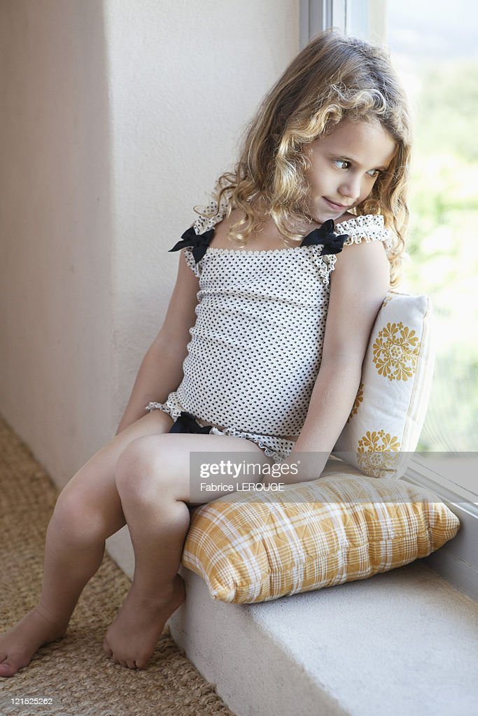 Cute Little Girl Looking Out From A Window High-Res Stock ...