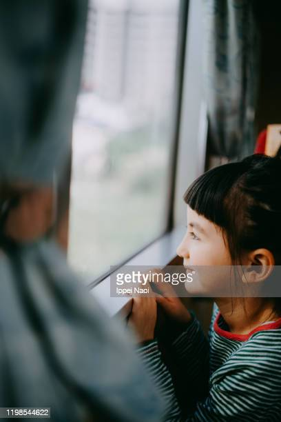 cute little girl looking outside train window - ippei naoi stock pictures, royalty-free photos & images