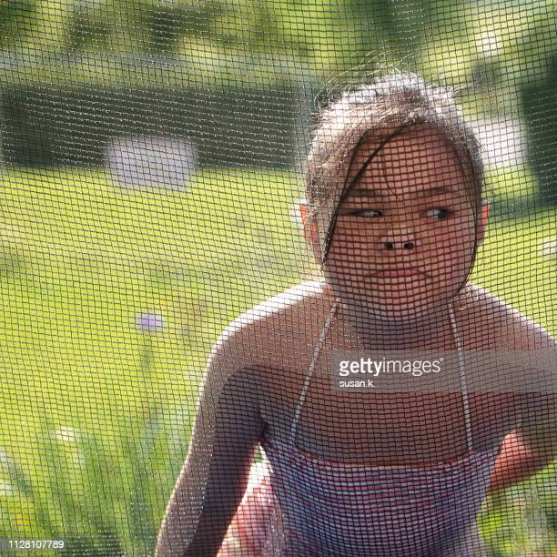 cute little girl making funny face at back yard. - ljubljana stock pictures, royalty-free photos & images