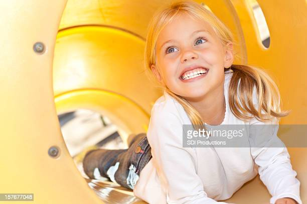 Cute Little Girl on a Playground Slide