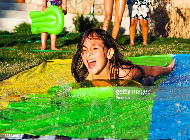 Cute Little Girl On Slip And Slide