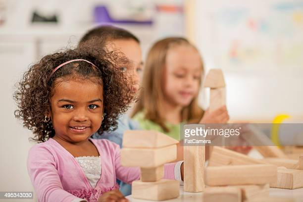 Cute Little Girl Playing with Blocks