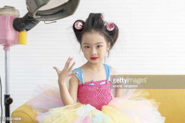 cute little girl playing with her mother's cosmetics. kid's fashion, cosmetics. pin-up style - vogue stock pictures, royalty-free photos & images