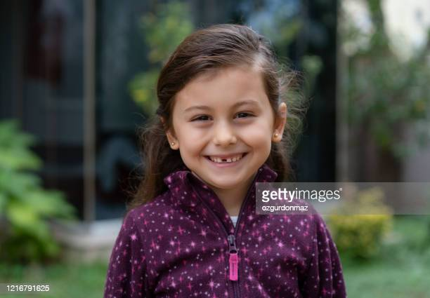 cute little girl portrait at the garden in front of the house - beautiful turkish girl stock pictures, royalty-free photos & images