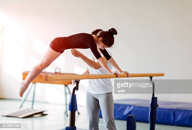 Cute Little Girl Practicing Gymnastics