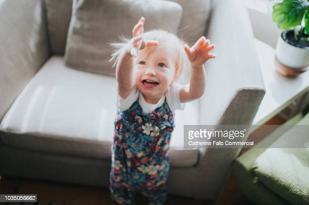 cute little girl reaching up - reaching stock pictures, royalty-free photos & images
