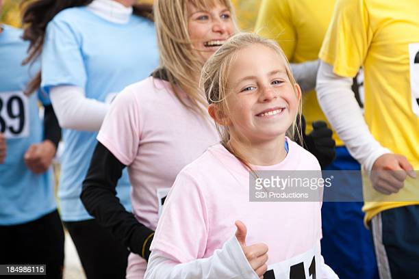 Cute little girl running at a charity event race