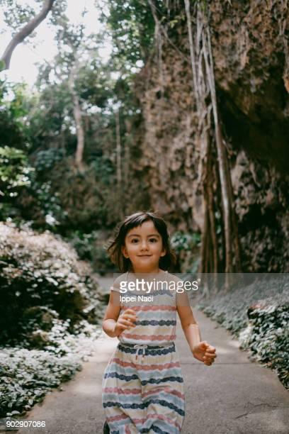 Cute little girl running towards camera