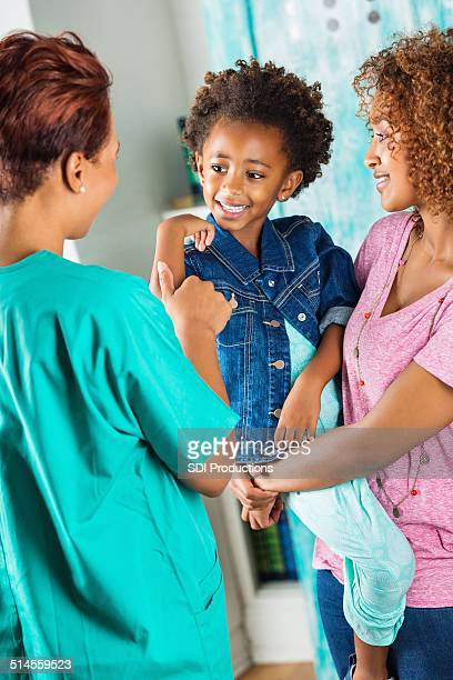 cute little girl showing nurse or doctor her wound - beautiful ethiopian girls stock photos and pictures