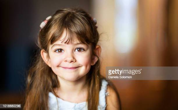 cute little girl (3-4) smiling and looking at camera - small faces stock pictures, royalty-free photos & images