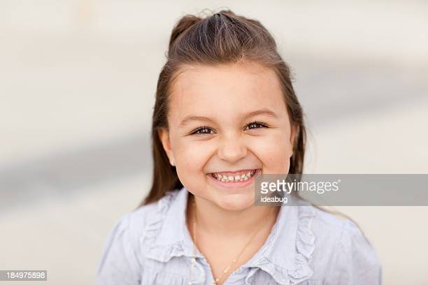 Cute Little Girl Smiling and Looking at Camera