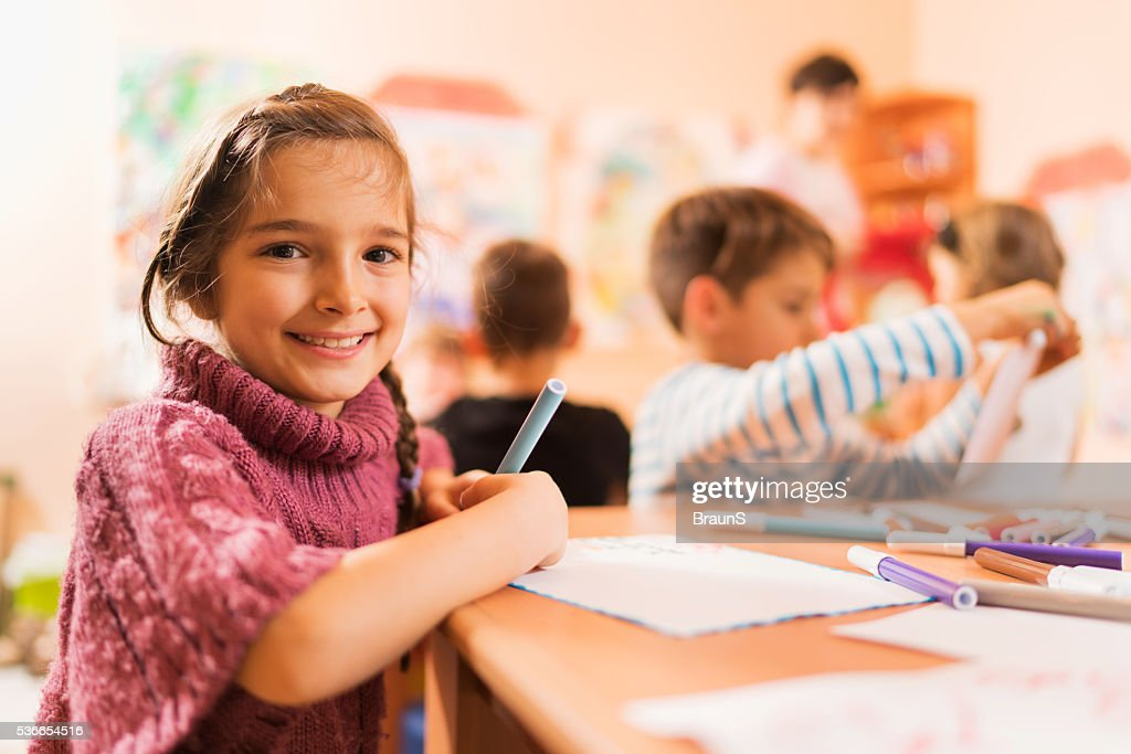 Cute little girl with her friends in a preschool. : Stock Photo