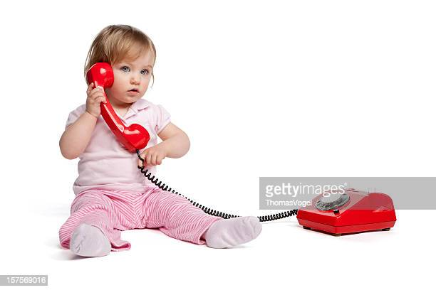 Cute little girl with red telephone