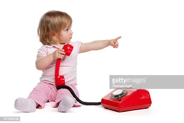 cute little girl with red telephonei - baby pointing stock photos and pictures