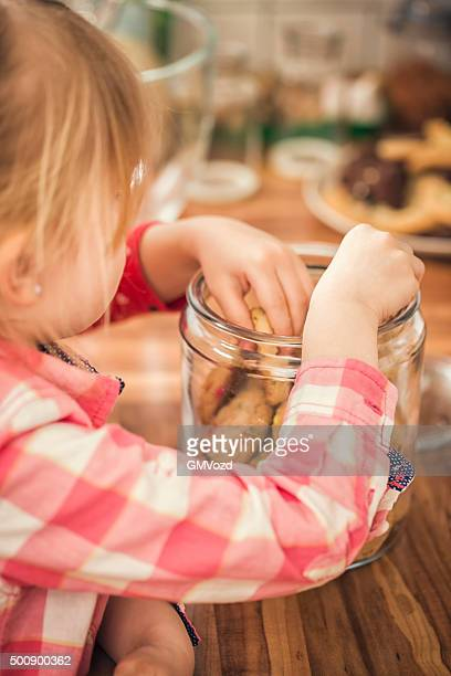Cute Little Girls Eating Chocolate Chip Cookie