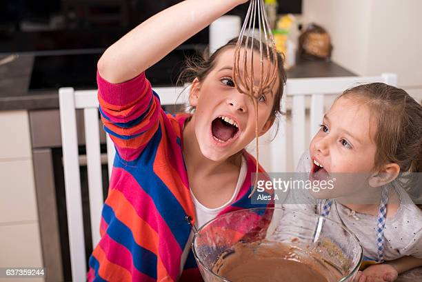 Cute little girls making muffins