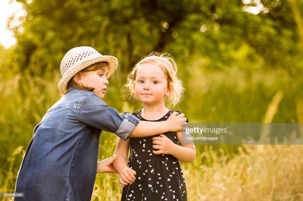 Cute little girls outside in in green summer nature. : Stock Photo
