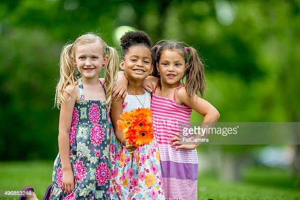 Cute Little Girls Standing Together at the Park