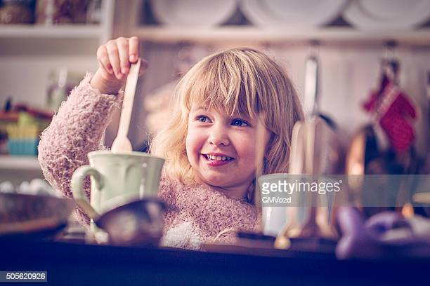 Cute Little Gril Preparing Hot Chocolate Bar with Spoon