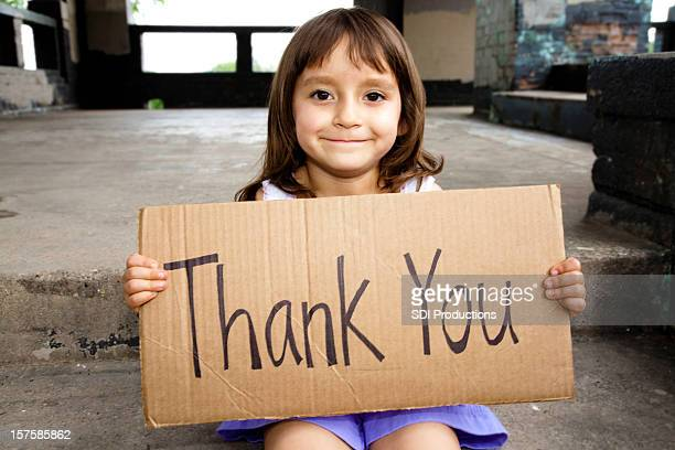 Cute Little Hispanic Girl Holding Thank You Sign