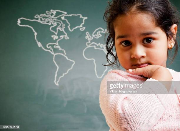 Cute Little Indian Preschool Girl in Front of World Map