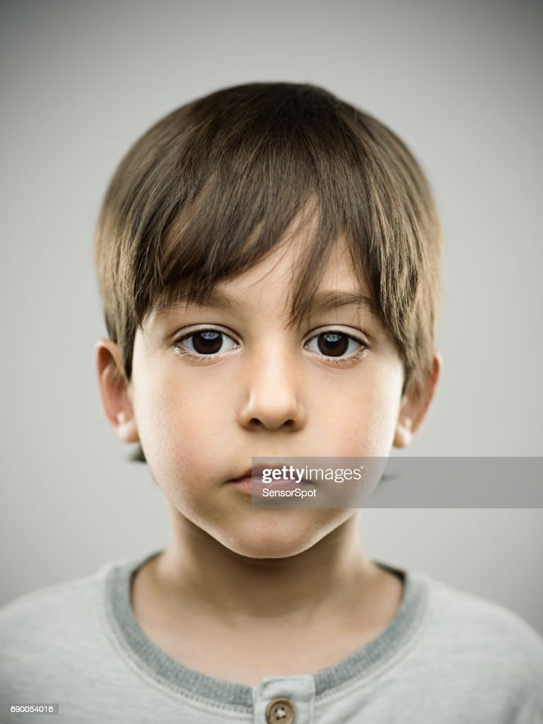 Cute little kid looking at camera : Stock Photo